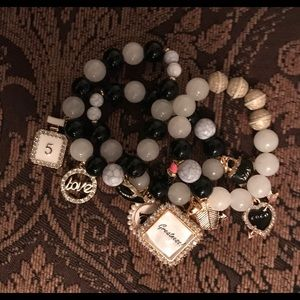 3 bracelets, black and white beads and gold charms